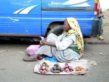 Woman trying to sell a few vegetables in a street of the Mercato area in Addis Ababa. Ethiopia.