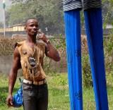 « Festival des 18 Montagnes de Man », Côte d'Ivoire. Partner of the dancer on stilts with protective amulets.