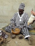 Fetishes and the sacrifice of a chicken help healer and soothsayer Ba Zane (Mossi tribe) in Sena, Burkina, to predict the future