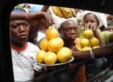 Women try to sell their fruit through car windows, Burkina Faso