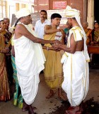 Wedding ceremony in Karnataka, India; the unity between the groom and the bride's father is being established