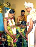 Forever united. The couple is tied together by threads; Wedding ceremony in Karnataka, India
