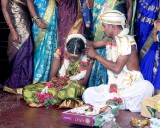 Tying the necklace that she will have to wear till her husband dies. It shows everybody that she is married; Wedding ceremony