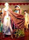 Tied together, bride and groom are walking around the holy fire; Wedding ceremony in Karnataka, India