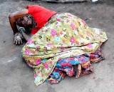 Banjara woman prostrating in Yellamma temple compound, Saundatti, Karnataka, India