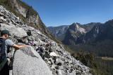 Scrambling over a large rock slide