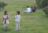 gorgeous little kids picking flowers