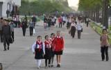 schoolgirls on a busy Pyongyang sidewalk