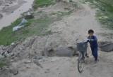 bashful child and bicycle
