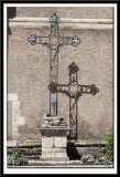 Cross by the wall.
