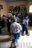 The Men from Section 1 praying at the altar