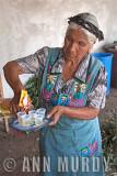 Natala pouring mezcal, Section 4