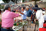 Section 1 presenting bottle of mezcal to the Presidente