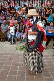 Masked dancer in women's traje