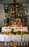Altar viejo with many santos