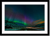 Aurora borealis and trail of  car light