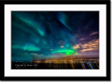 Aurora borealis and the city light of Akureyri
