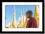 A novice monk in front of a temple