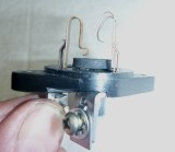 Washer glued in place as buffer