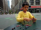 Assembling newly acquired toys in Herald Square