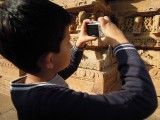 Photographing the temple reliefs