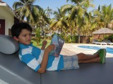 Reading Harry Potte poolside while suffering from a fever