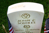Note the coin atop the headstone