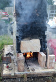 The hand-built kiln fired up again