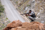 Somaliland Special Protection Unit (SPU) taking aim with his AK-47