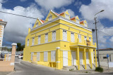 A bright yellow restored building for rent, Otrabanda