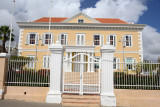Civil Registry in an old Dutch mansion behind a white gate, Otrabanda