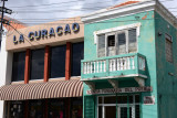 La Curaçao and a Funeral Home with its sign in Spanish