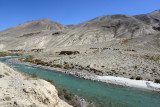 A camel caravan on the Afghan side of the Pamir River in the narrow Wakhan corridor of northeastern Afghanistan