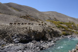 The Afghan caravan continues on its way along the Pamir River