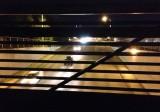 View through the railing of the Interurban Trail bridge over South 180th Street