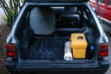 BED SYSTEM 1: Seat backs folded down for diagonal sleeping in Subaru GL wagon (004)