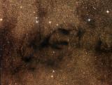 Les nébuleuses sombres Barnard 65, 66, 67