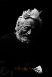 Aged man with eyes closed in monochrome