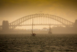 Sydney in mist with tallship and yacht