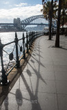 Railings leading down to Sydney Harbour with bridge backdrop