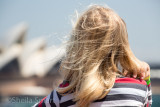 Little blonde girl on ferry with Sydney Opera House backdrop