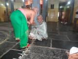 Sri N S Krishna Iyengar felicitating Maduai Arangarajan swami