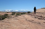 Slick rock walking looking to the La Sal mountains, Arches NP