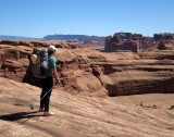 Martina looks out for our rocky descent scramble towards Courthouse Towers, Arches NP