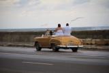 newly weds cruising on the Malecon, Havana