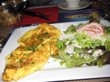An omelette with salad at Café Monge