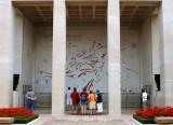 Visitors at Battle Map, Normandy American Cemetery, Colleville-sur-Mer, France