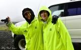 Nancy and Katherine in rain gears, David in car