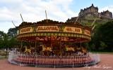 Carousel in shadow Edinburgh Castle, Princes Street Gardens, Edinburgh, Scotland, UK