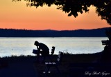 Enjoying the book at sunset Olympic Mountains, Puget Sound, Emma Schmitz park, West Seattle